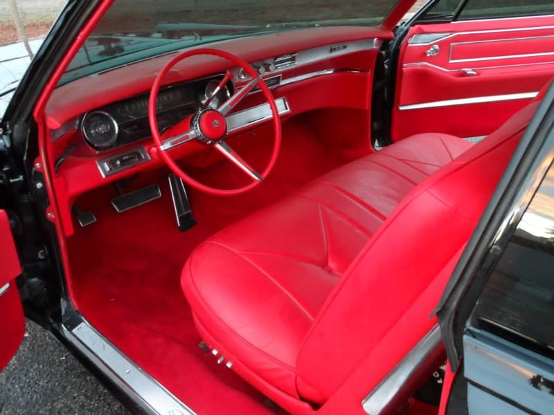 Ursala ~ 1966 Cadillac Striking Red Interior