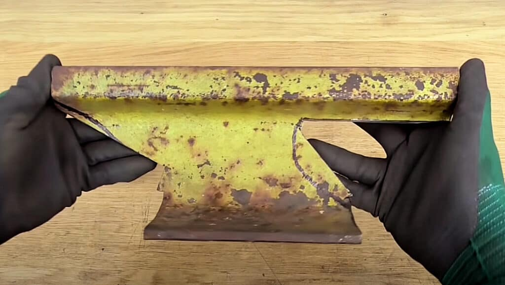 Railroad track anvil rough cut into shape with an angle grinder.
