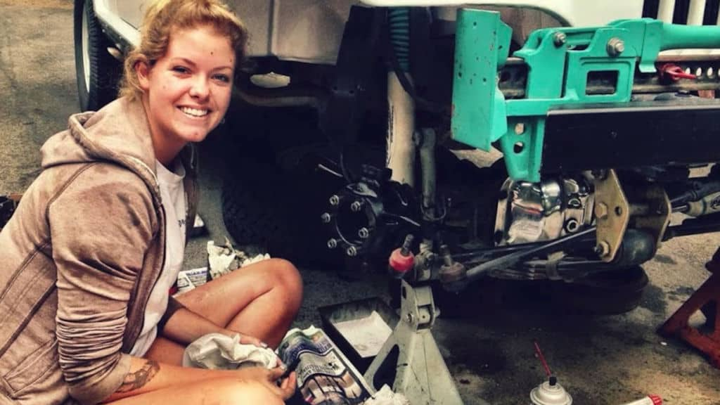 Kate Cook works on 1966 Jeepster Commando